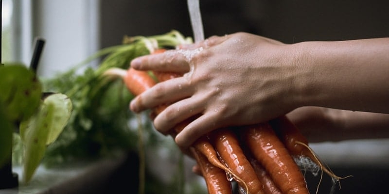 Person washing carrots